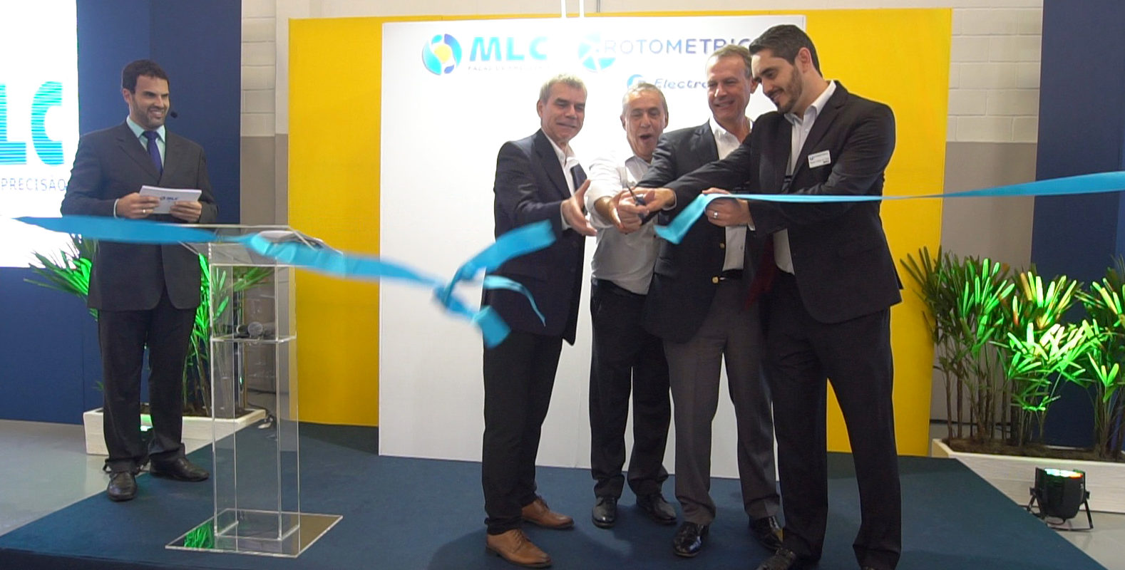 Ribbon cutting for grand opening of the new RotoMetrics / MLC flexible die plant in São Paulo, Brazil.